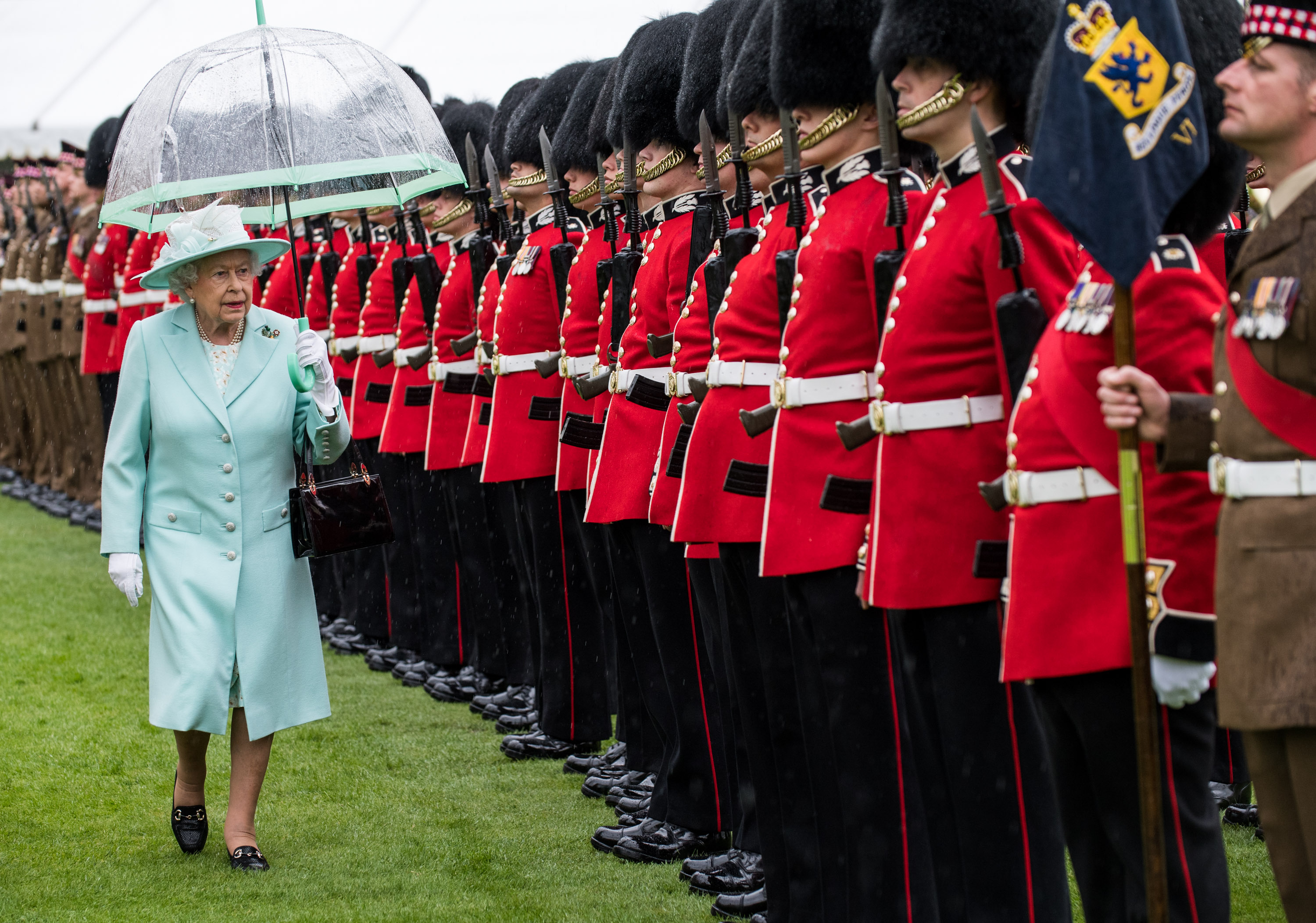 in pictures  queen presents new colours to scots guards