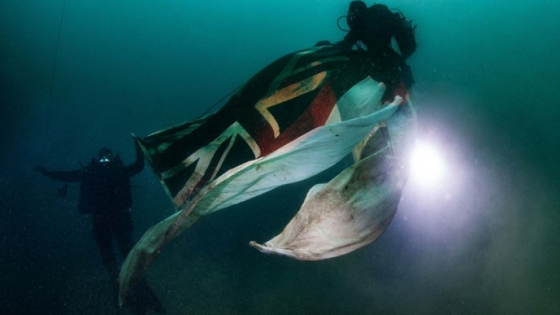 Royal Navy divers carry White Ensign to site of HMS Royal Oak