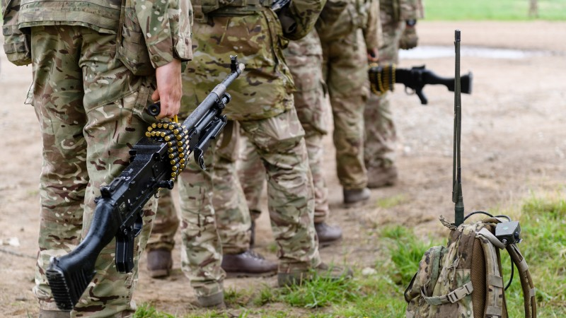 Anonymous British Soldiers From 5 RIFLES With GPMG's & Bowman Radio On Exercise Spring Storm