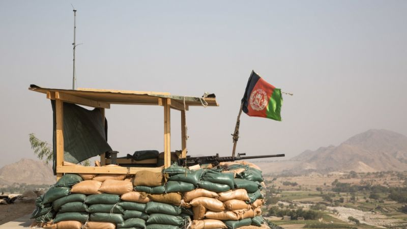 Afghan flag flies over an observation post, Pekha Valley, Achin District, Nangarhar Province, Afghanistan