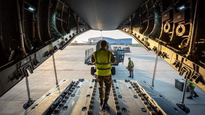 Armed Forces member helps loading oxygen equipmen ton A400M RAF aircraft for coronavirus support falklands 220420 CREDIT MOD