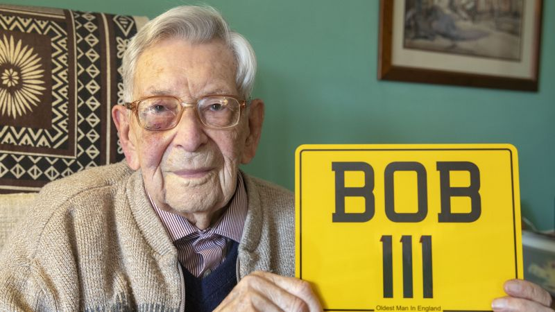Bob Weighton with his new number plate to mark his birthday (Picture: PA).