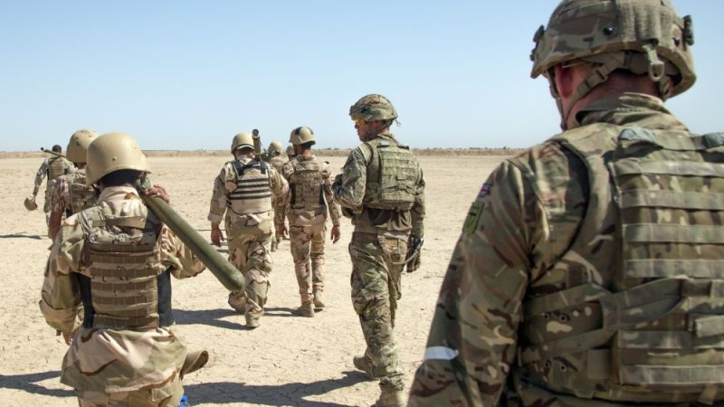 British Army trainers and Iraqi security forces personnel in Besmaya range Iraq