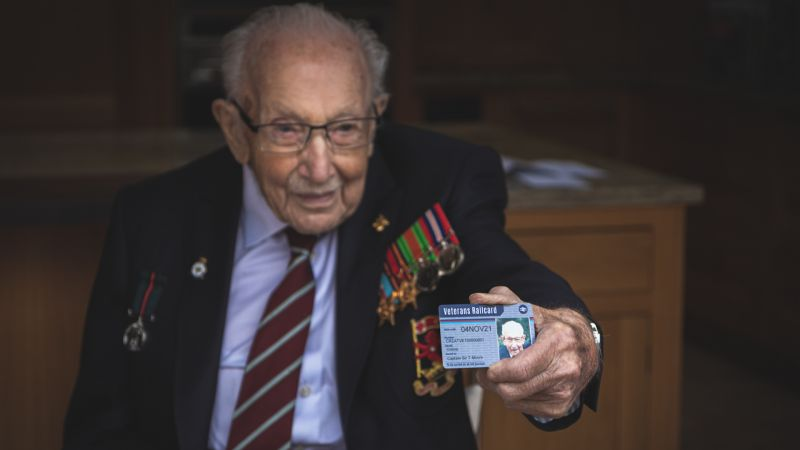 Captain Sir Tom Moore poses with first ever Veterans Railcard 131020 CREDIT Department of Transport.jpg