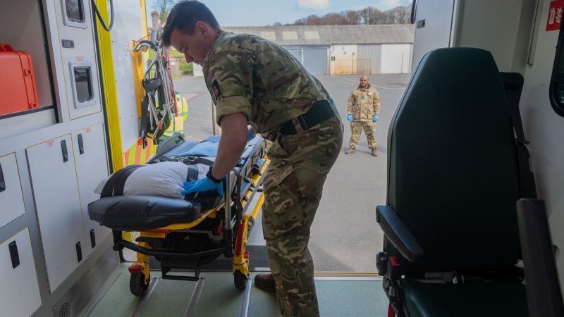 Coronavirus Welsh Ambulance Service - a member of Seven Brigade loads a stretcher onto an ambulance ready for use 060420 CREDIT MOD.jpg