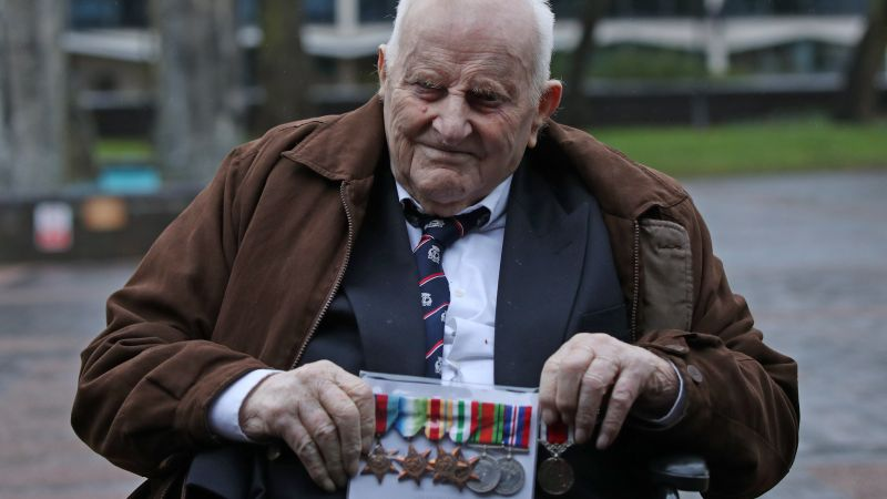 97-year-old veteran Douglas Meyers outside court with his medals