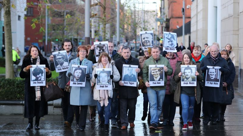 Family members outside Laganside Courts in Belfast hold images of some of those who were killed in disputed circumstances over the course of three days 091219 CREDIT PA.jpg