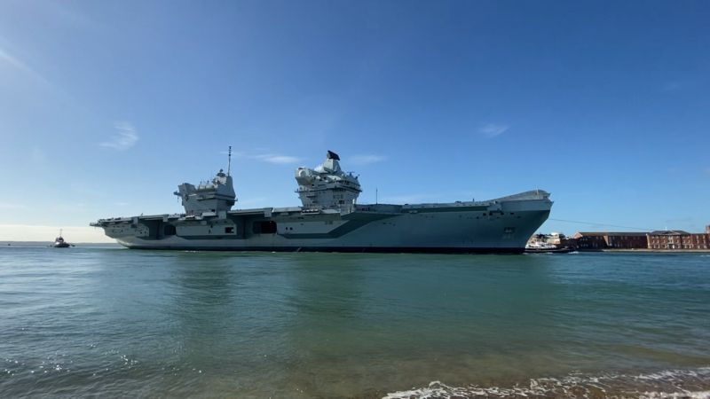 HMS Queen Elizabeth returns to Portsmouth with tugs 151020 CREDIT BFBS 3