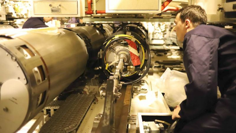 HMS Talent personnel look at Spearfish MOD 1 torpedo during trials off Isle of Skye 050221 CREDIT Royal Navy (2).jpg