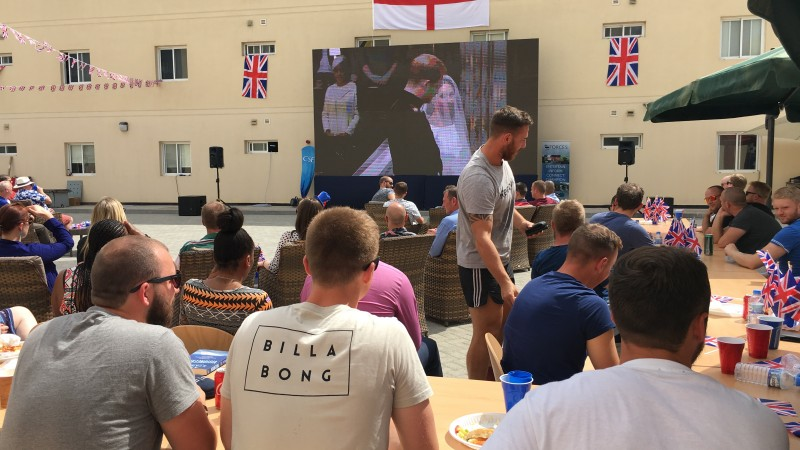 Serving personnel in Bahrain watching the Royal wedding on a CSE big screen