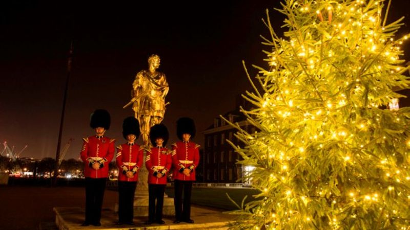 Irish Guards bandsmen stand by Royal Hospital Chelsea Christmas Tree