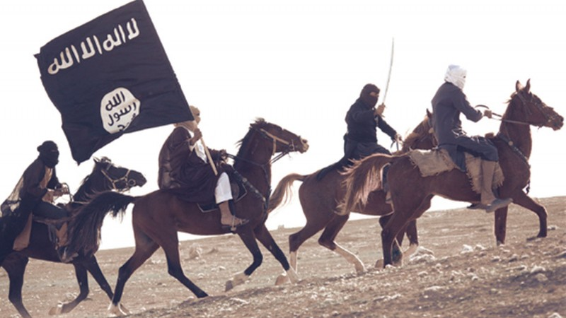 Islamic State Fighters pose on horseback in IS's Dabiq Magazine