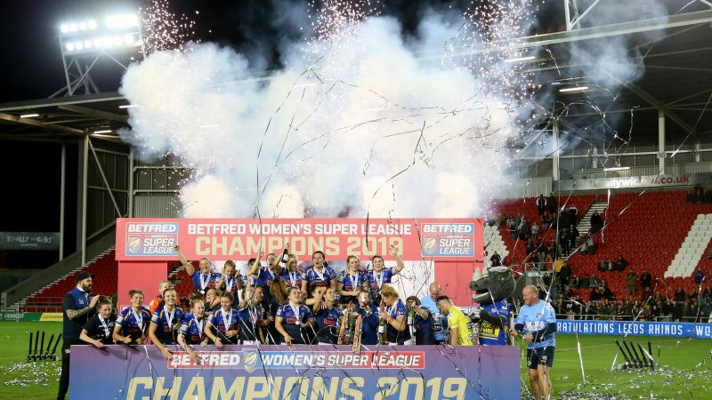 Leeds Rhinos Women celebrate after winning after the Betfred Women's Super League Grand Final at the Totally Wicked Stadium, St Helens