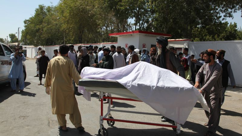 Local people carry the body of a civilian in Lashkar Gah, capital of Helmand province, Afghanistan 230919 CREDIT PA.jpg