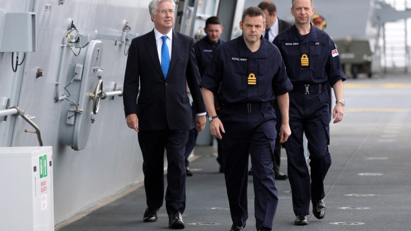 Sir Michael Fallon (left) visited the largest and most powerful ship built for the Royal Navy for the first time at sea today.