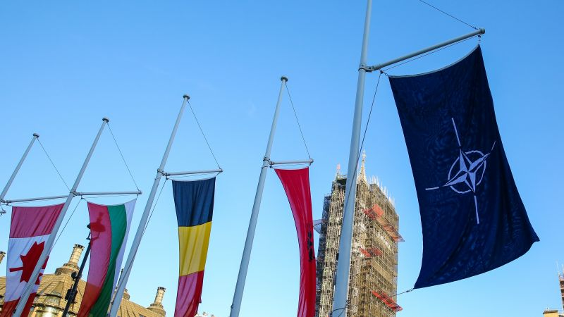 NATO flag and alliance member flags flying in London's Parliament Square