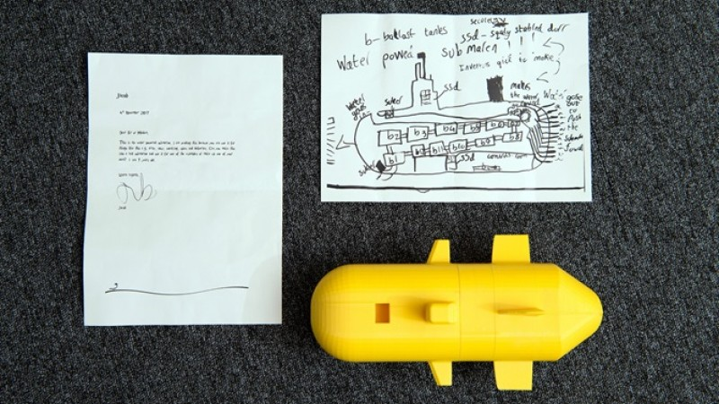 Model submarine and child letter