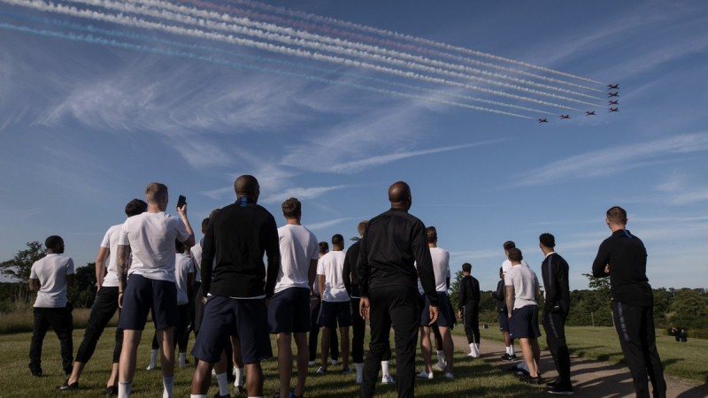 Red Arrows fly over the England squad