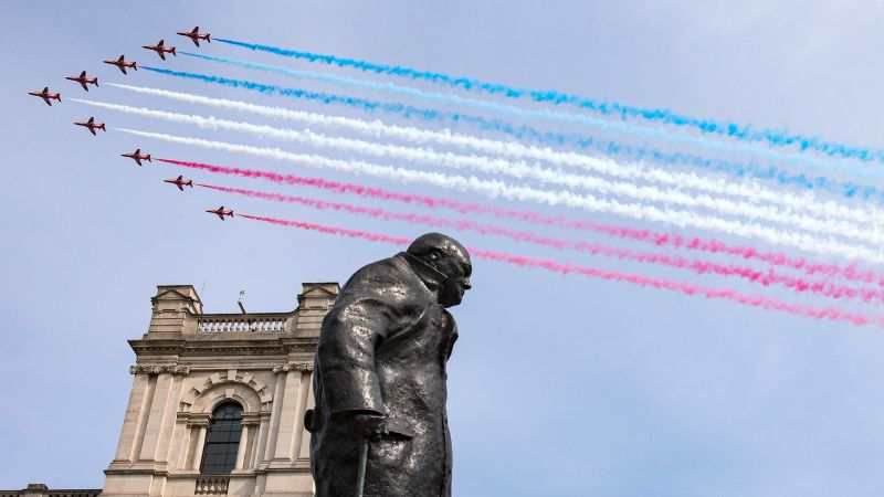 Royal Air Force Red Arrows flying over the statue of Sir Winston Churchill on the 75th anniversary of VE Day. 080520 CREDIT MOD