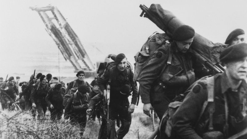 Royal Marine commandos moving off the Normandy Beaches on D-Day 06061944 CREDIT PA .jpg