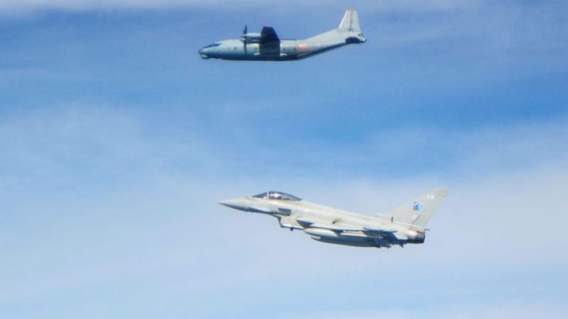 Russian Antonov AN-12 aircraft (top) with an RAF Typhoon