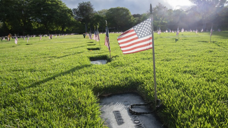 US flags over un known soldier's tomb from the Korean War at the National Memorial Cemetery of the Pacific in Honolulu, Hawaii. (Pictures: PA Images)