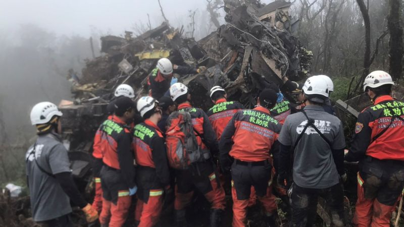 Search and rescue teams tending to the site of the crash (Picture: Reuters).
