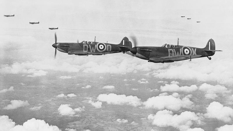 Supermarine Spitfire Mark IAs, (N3289 'DW-K and R6595 'DW-O' nearest), of No 610 Squadron, Royal Air Force based at Biggin Hill, Kent, flying in three 'vic' formations Credit Imperial War Museum © IWM (CH 740)