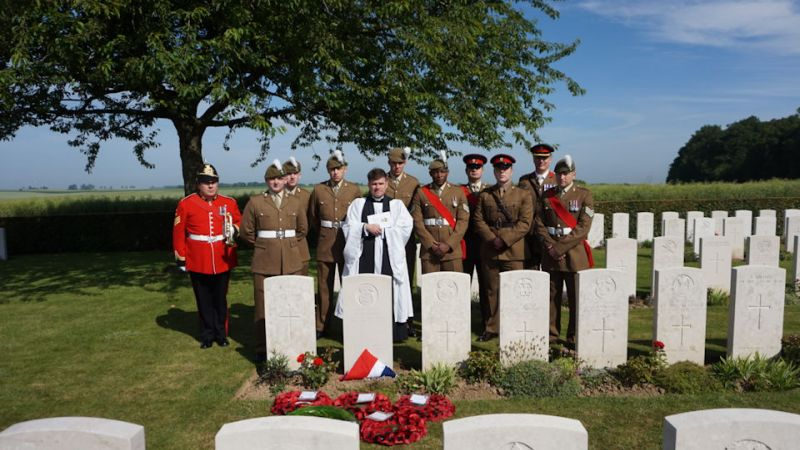 The military party gather at the graveside of Cpl Davies 190619 CREDIT Crown Copyright.JPG
