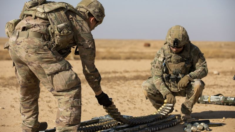 US soldiers prepare unserviceable ammunition to be destroyed through a controlled detonation at Al Asad Air Base, Iraq