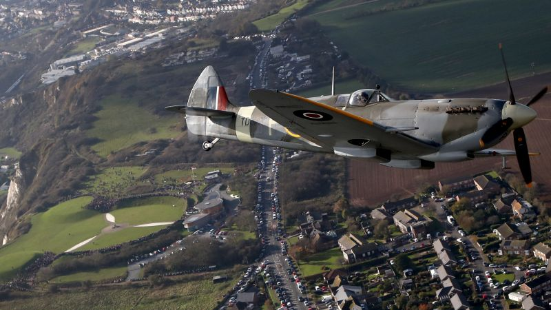 World War II Spitfire, flies over the Battle of Britain Memorial in Folkestone, Kent, in a tribute to the fallen on Remembrance Day 101119 CREDIT PA.jpg