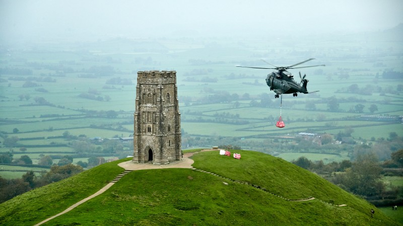 IN PICTURES Royal Navy Helicopter Helps Preserve Iconic Landmark