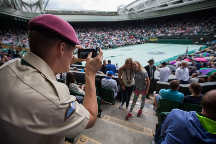 Private O'Brien takes a picture for spectators on Centre Court