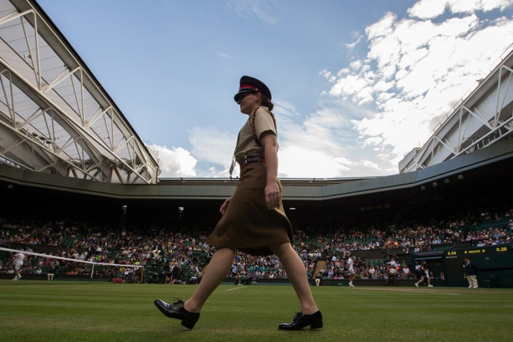 Private Richards leaves Centre Court to monitor for court intrusion between games