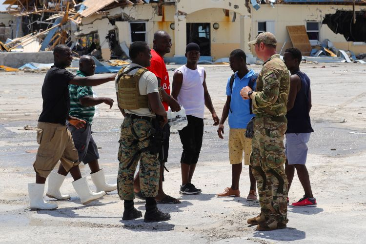 A British soldier part of a team from RFA Mounts Bay, providing aid assistance to the Islanders of Great Abaco 040919 CREDIT MOD