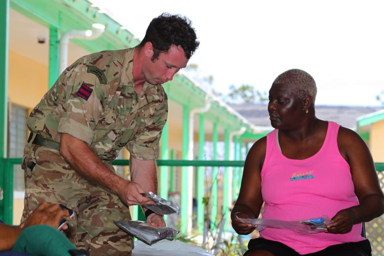 British soldier part of a team from RFA Mounts Bay, providing aid assistance to the Islanders of Great Abaco 040919 CREDIT MOD