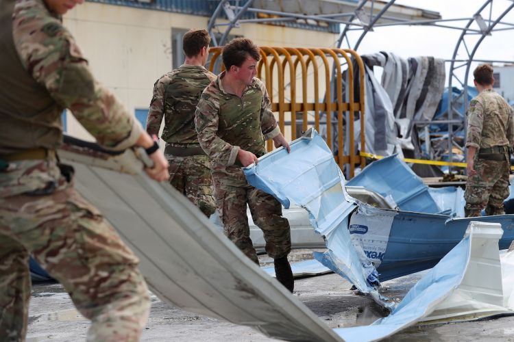 British soldiers from the Humanitarian and Disaster Relief team from RFA Mounts Bay provide assistance in Great Abaco, Bahamas, after Hurricane Dorian CREDIT MOD 040919