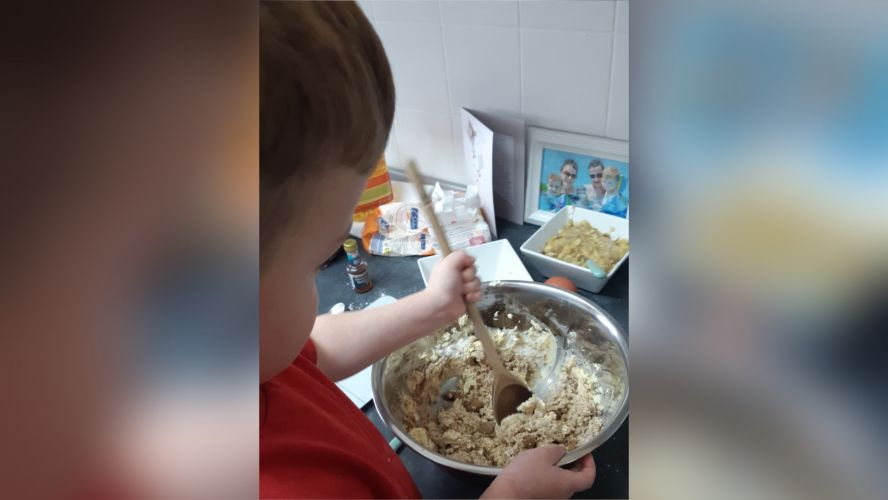Child helping mummy bake