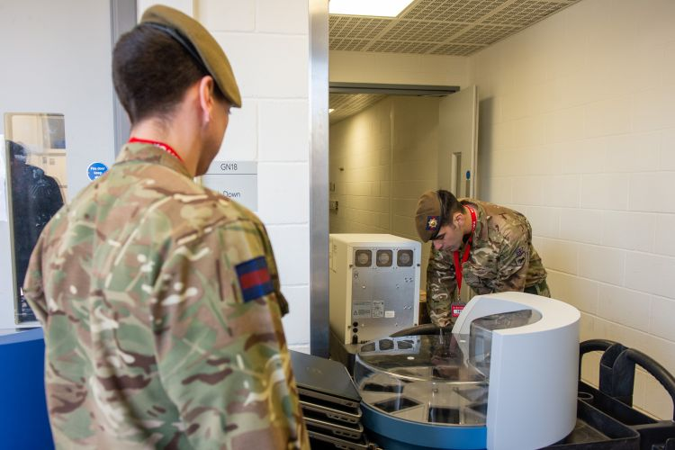 Members of the Coldstream Guards prepare to move medical equipment for the NHS (Picture: MOD).