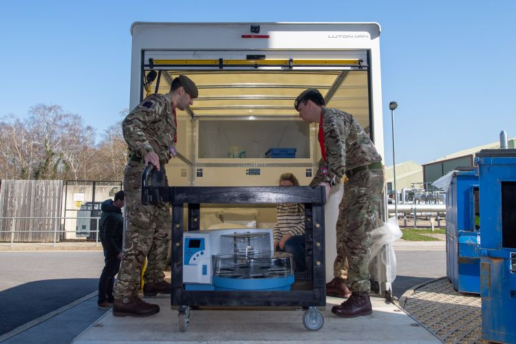 Members of 1st Battalion Coldstream Guards load medical equipment for the NHS (Picture: MOD).