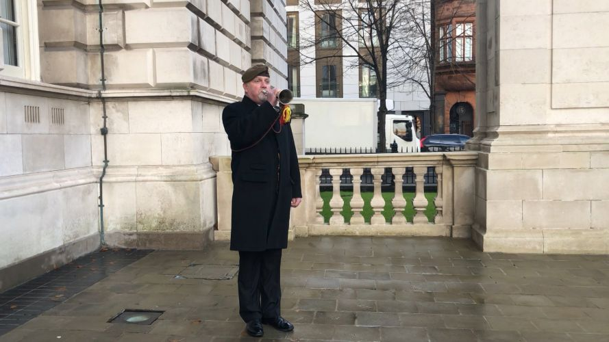 The Last Post sounds during Armistice Day commemorations in Belfast.