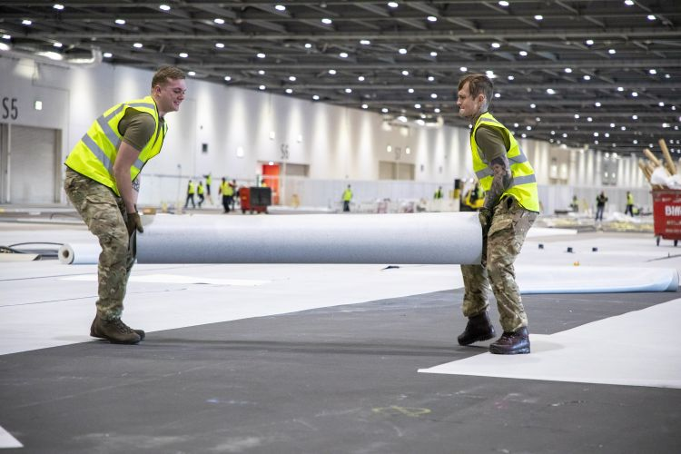 Members of 1 Royal Anglian Regiment help build the NHS Nightingale Hospital at the ExCel Centre in London (Picture: MOD).
