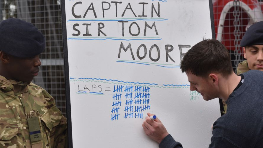 Military personnel tick off a tally for laps completed as part of the Captain Tom 100 Challenge (Picture: MOD).
