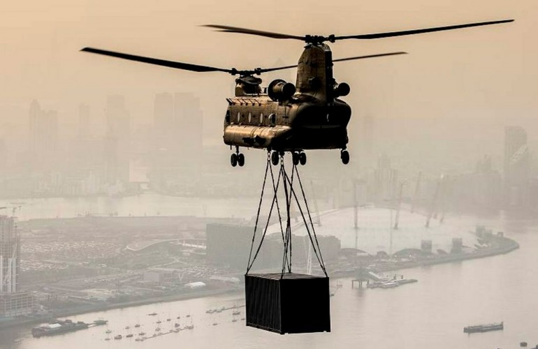 An RAF Odiham Chinook Helicopter with an underslung load over London