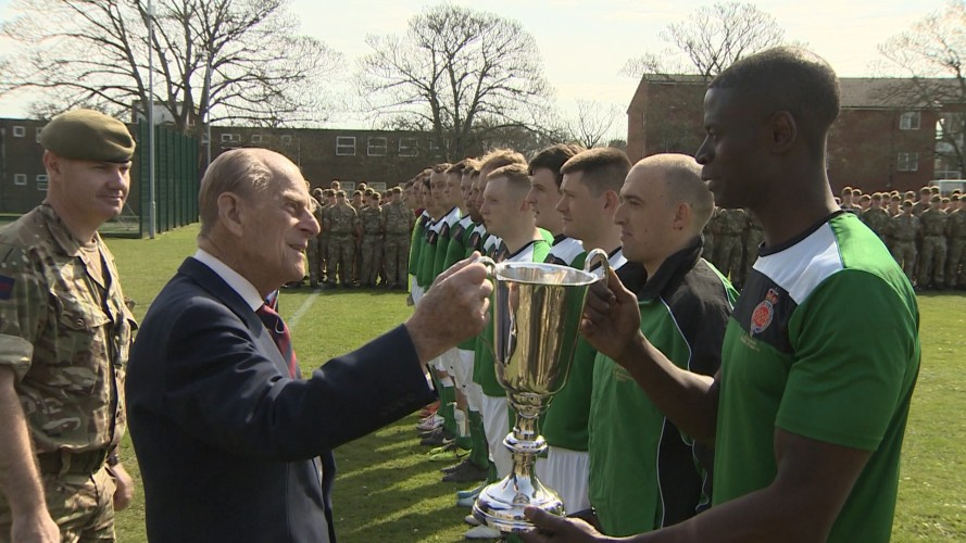 The Duke of Edinburgh presents the Grenadier Guards with a football trophy, March 2017.