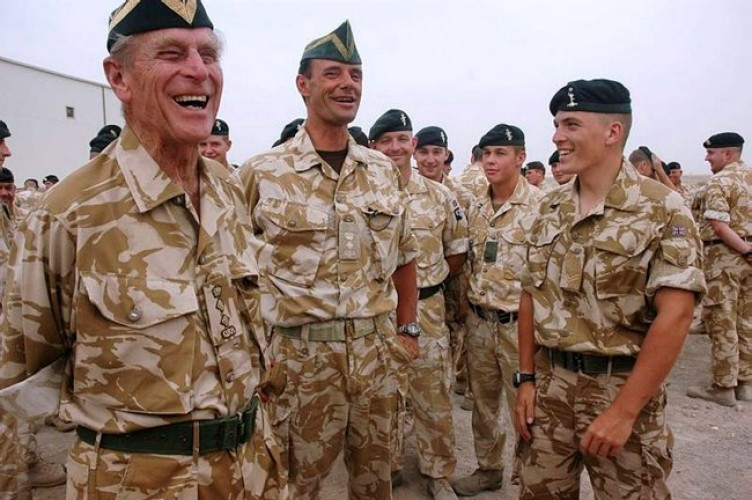 The Duke of Edinburgh shares a joke with the Commanding Officer and soldiers of the Queen's Royal Hussars Battle Group at Basra Air Station in Iraq, October 2006.