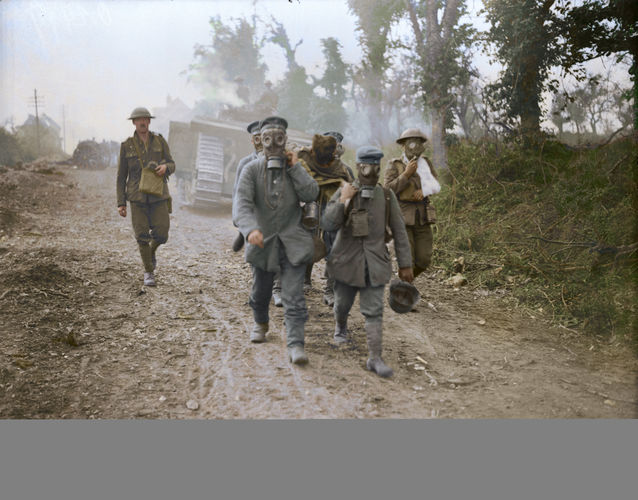 Prisoners bring in wounded wearing gas in August 1918 (Picture: The Vimy Foundation).