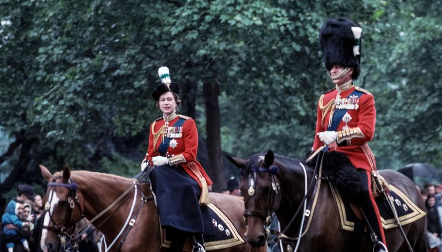 The Queen and Prince Philip during the 1963 Trooping the Colour (Picture: Michele and Tom Grimm/Alamy).
