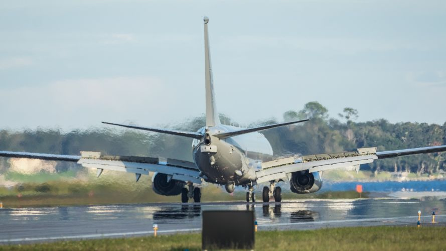 RAF new P-8A Poseidon aircraft from behind landing on NAS Jacksonville runway (Picture: MOD).