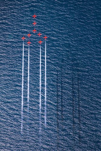 Red Arrows perform Concorde over the deep blue sea of Greece CREDIT RAF